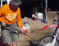 Paul cleaning up after all the little motocrossers